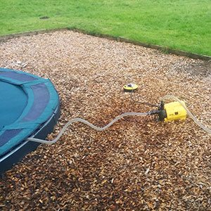 Above ground pump for trampoline drainage