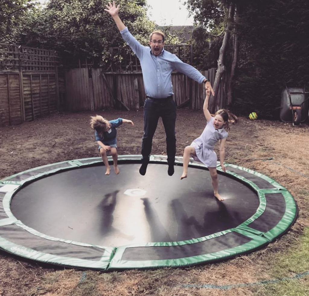 dad and girls on trampoline