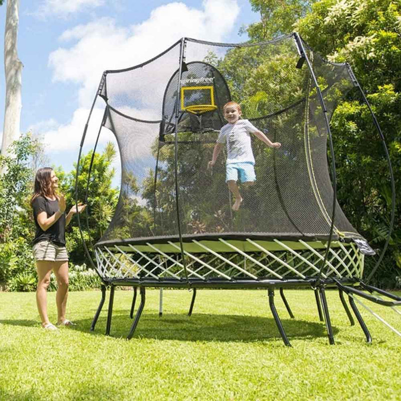 Children playing on Springfree 8ft Trampoline