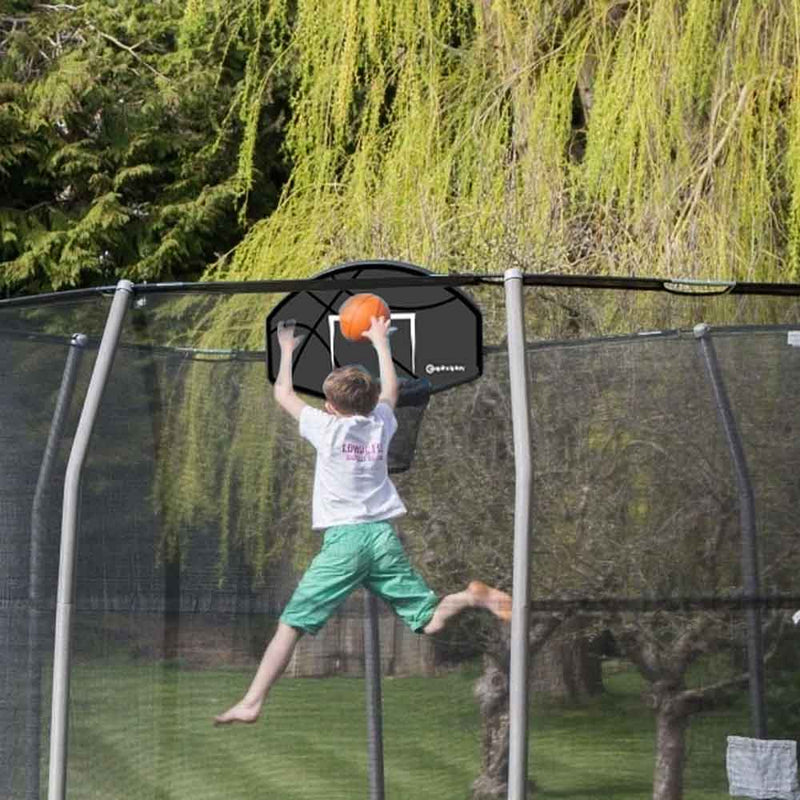 Child playing with basketball hoop