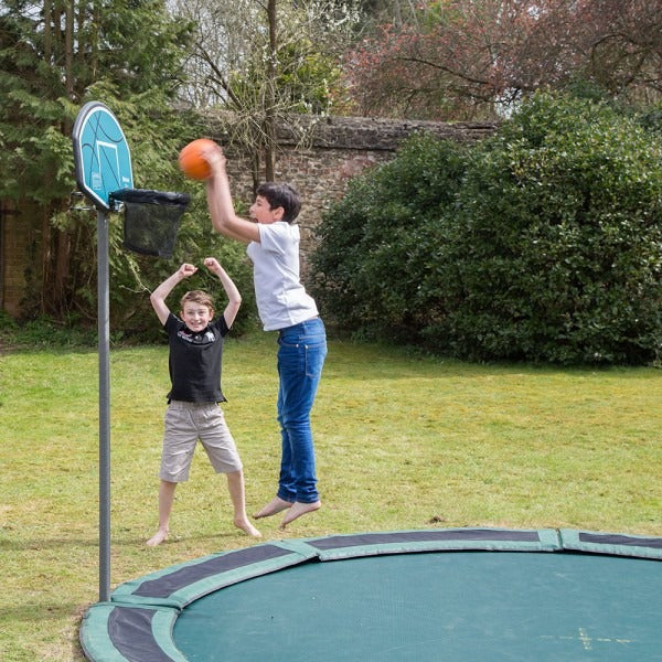 Children playing with basket ball hoop