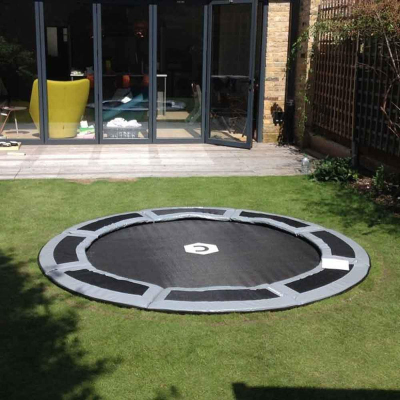 8ft in-ground trampoline in small backyard