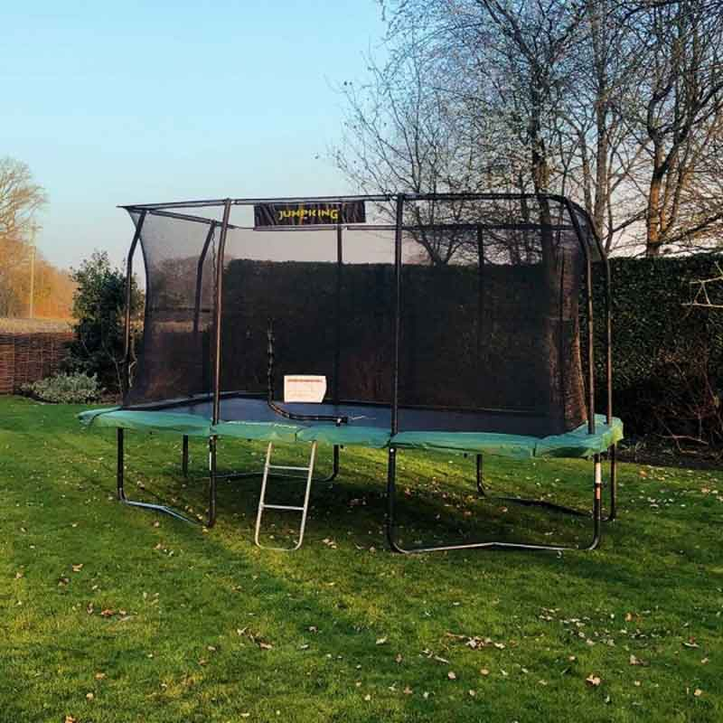 Jumpking trampoline on lawn