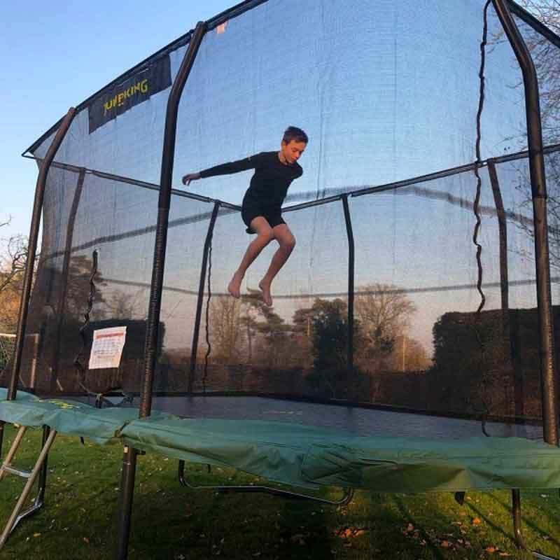 Boy jumping on Jumpking trampoline