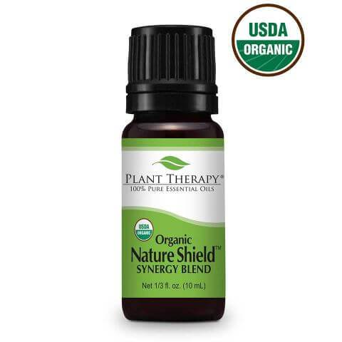 10ml bottle of nature shield essential oil blend, black bottle with green label and black plastic screw top