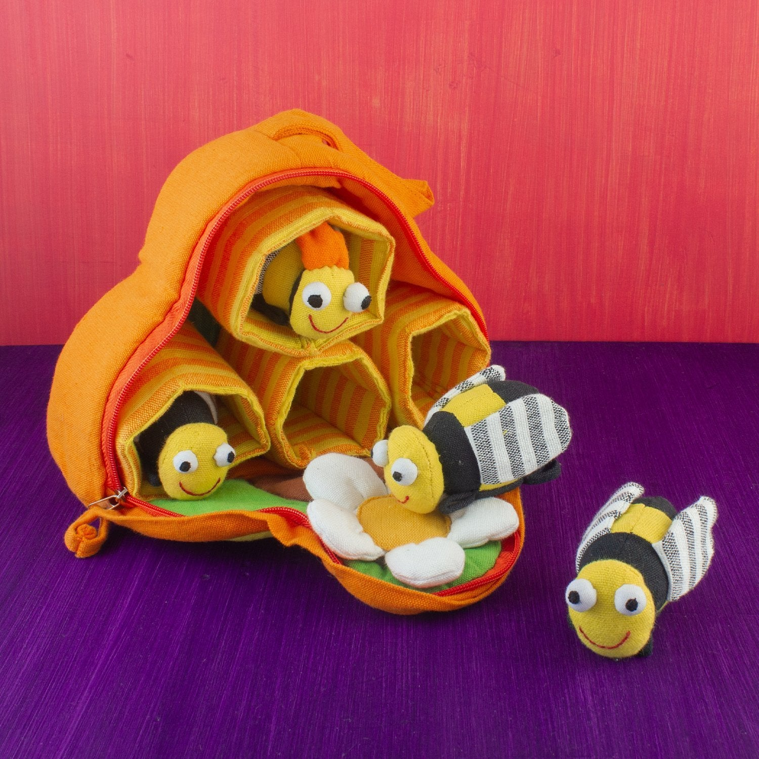 Plush toy, beehive with four toy bees and four hive spaces