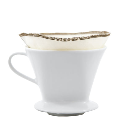 Reusable, organic cotton coffee filters made in the USA. #2 filter size. creme colored with brown threading, shown inside pour over ceramic mug