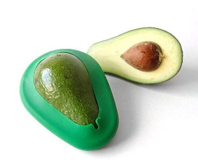 avocado slice, and avocado hugger on ripe avocado
