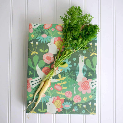 one gift wrapped with wrappily enchanted garden design, with white carrots + leaves on top