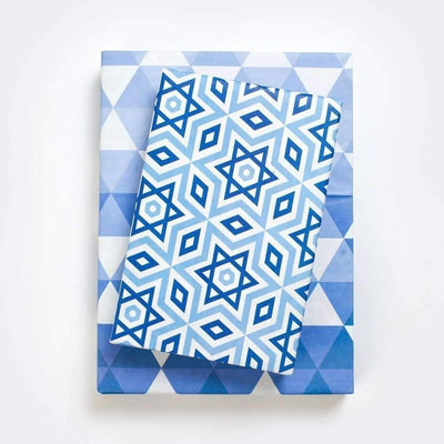 two packages wrapped in Hannukah paper (blue star design)