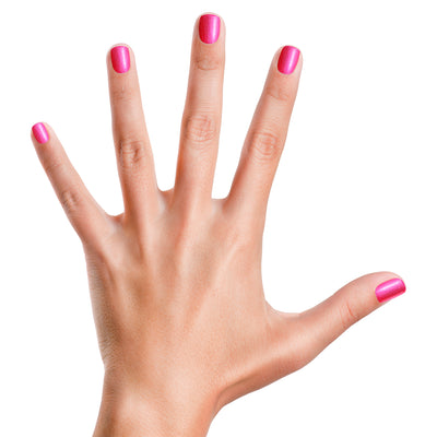 hand with pink piggy paint nail polish applied to each nail
