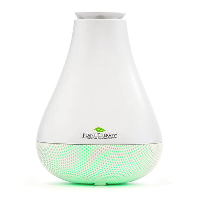 white pear shaped diffuser with mesh bottom that glows green