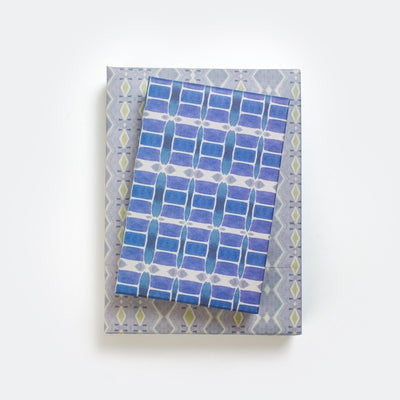 gifts stackes with wrappily wrapping paper, riptide design