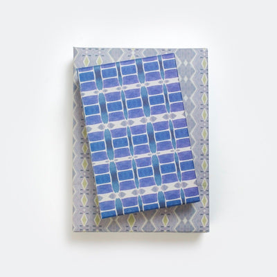 gifts stacked with wrappily wrapping paper, riptide design, blue and grey