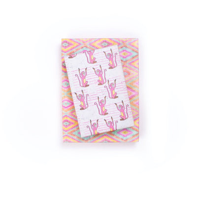 gifts stacked with wrappily wrapping paper, pink monkey design, reversible
