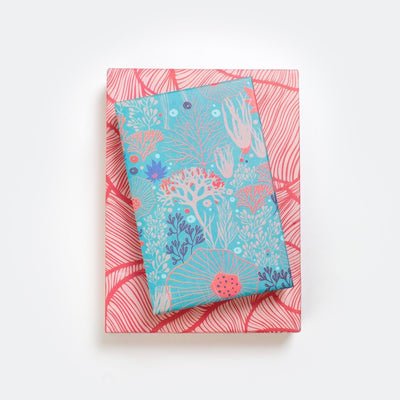 gifts stacked with wrappily wrapping paper, underwater flora design, reversible blue and red