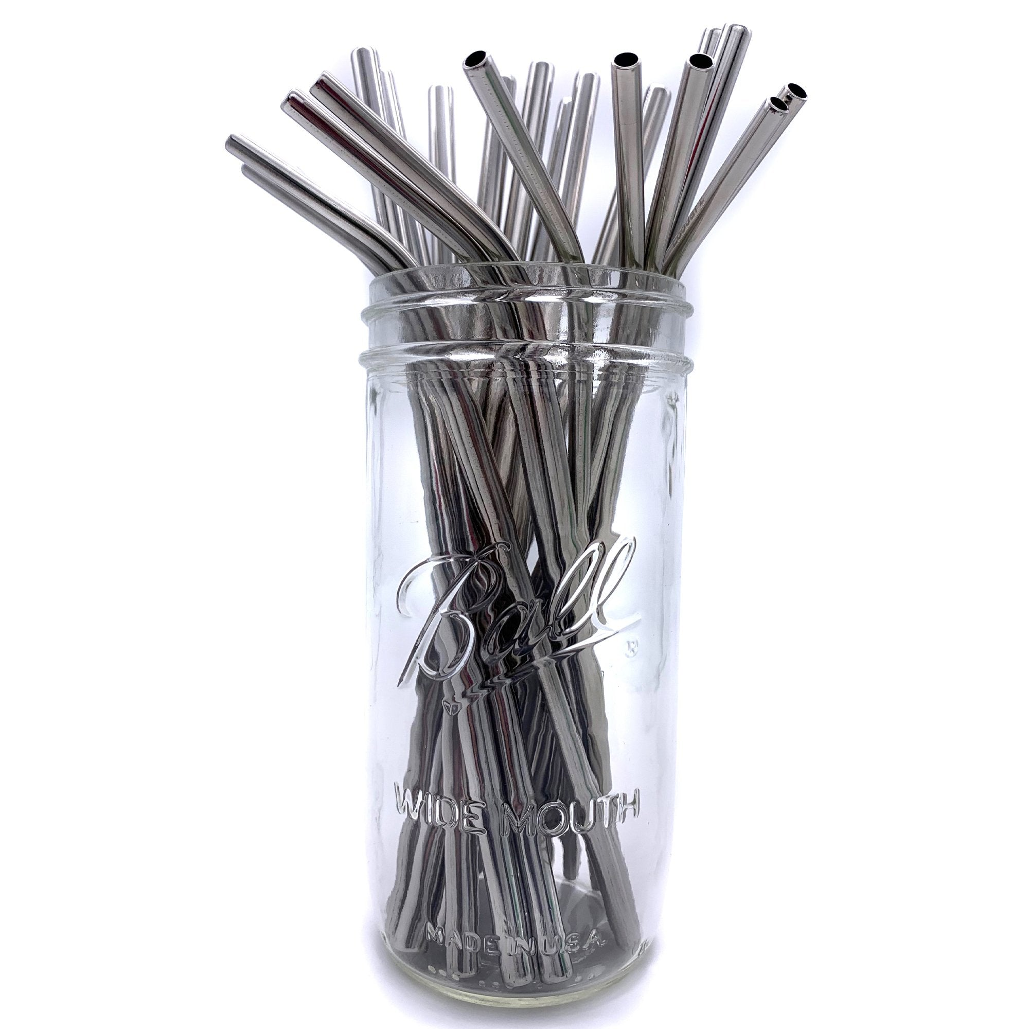 Reusable stainless steel straws in tall glass mason jar