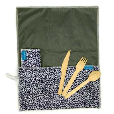 unrolled , anti-microbial place mat.Includes matching napkin and wooden cutlery. Blue flowers, with green interior.