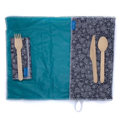 unrolled , anti-microbial place mat.Includes matching napkin and wooden cutlery. Grey flowers with teal interior.
