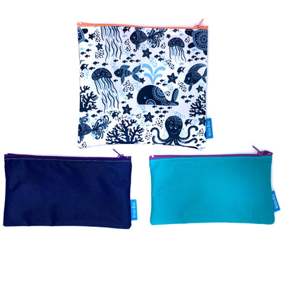 3 reusable sandwich bags and snack bags. 1 plain blue with purple zipper, 1 dark blue with purple zipper, 1 blue with sea creature design and orange zipper,