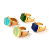 Gold band cocktail rings with square green stone, light blue stone, light green stone and dark blue stone