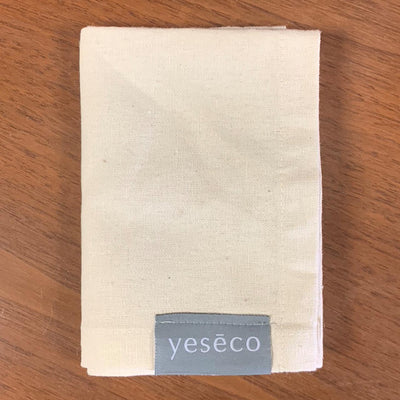 Light beige hemp & cotton tea towel with gray label that reads Yeseco