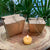 Set of 6 or 12  tea lights without metal or poly cups, just naked. . naturally colored and aromatic, infused with the sweet, subtle scent of honey. They arrive in kraft paper 'Chinese take out' packages.