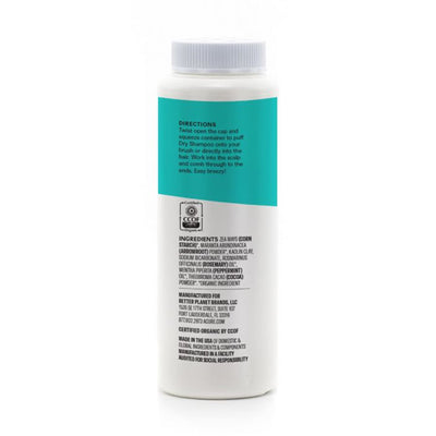 view of back, Teal and white Acure dry shampoo bottle, with directions, ingredients, and CCOF seal