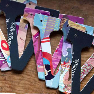 "seven designs of the letter ""V"", placed on exposed wood. Designs feature pages of children's picture books."