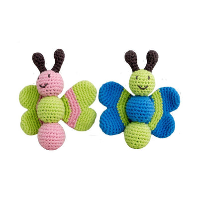 two knitted smiling butterfly shaped baby rattles on white backdrop, butterfly on the right has blue and green coloring, butterfly on the left has pink and green coloring
