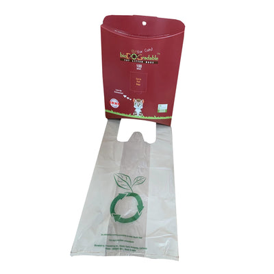 Red Cat waste bag, open with cat waste bag displayed in front of the container. green recycling logo on front of cat waste bag