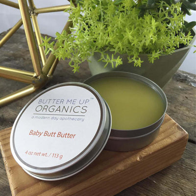 4 oz circular tin of baby butt butter, lid ajar