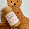 teddy bear holding cardboard baby powder container, 4 fluid ounces