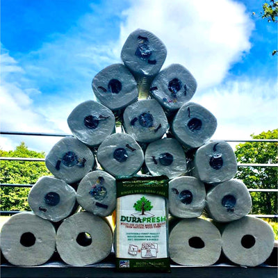 outdoor pyramid of paper towels surrounding 1 package of dura fresh cloths.