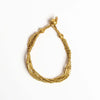 golden looped seed + barrel bracelet beaded bracelet