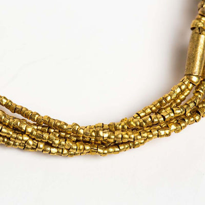 close up of beads, golden looped seed + barrel bracelet beaded bracelet