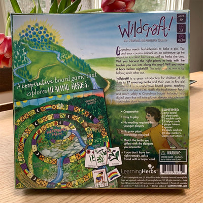 reverse side of wildcraft game box, with plot of game and contents list.