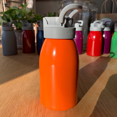 orange aluminum bottle with grey straw lid and handle, 12 oz.