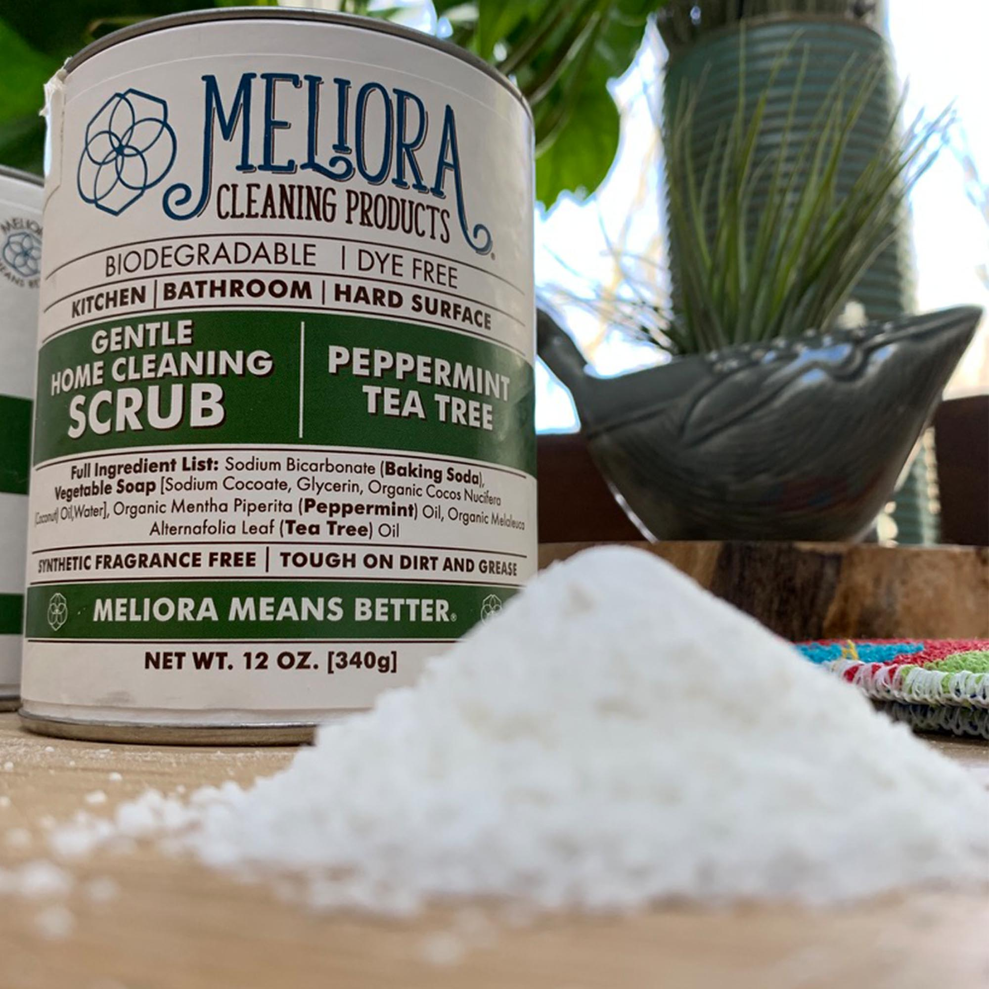 12 oz meliora cleaning scrub can, peppermint tea tree green, soap shavings in foreground