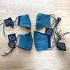 4 blue denim elastic free face masks on wood table top