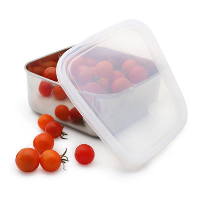 square stainless steel container with rounded corners and plastic lid ajar. container filled cherry tomatoes