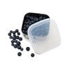 square stainless steel container with rounded corners and plastic lid ajar. container filled with blueberries
