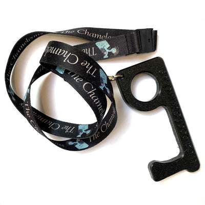 "black plastic go key attached to lanyard with ""the chameleons"" logo"