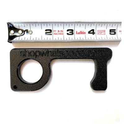 black plastic go key with tape measure to show scale