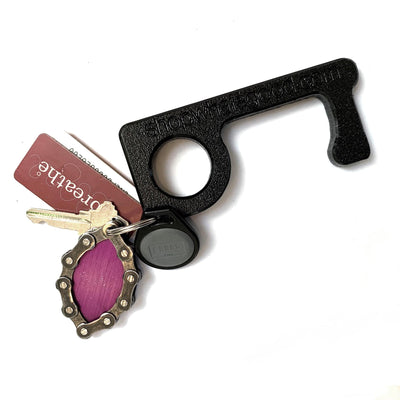 black, plastic go key with keychain attached