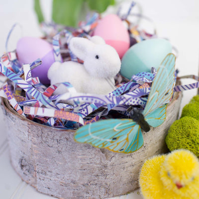 birch bowl filled with easter decor, bunny, chic, butterfly, colored eggs, and eco shred basket filler