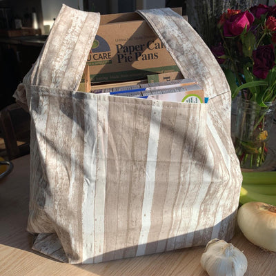 "barn wood design shopping bag filled with cardboard ""if you care"" products."