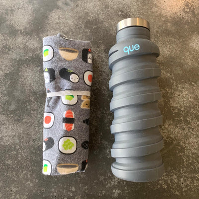 rolled up sushi design placemat with white elastic, and collapsable que water bottle, grey