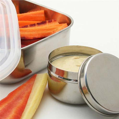 stainless steel container, lid ajar, container filled with hummus, carrots and pepper slices in 2nd rectangular stainless steel container.