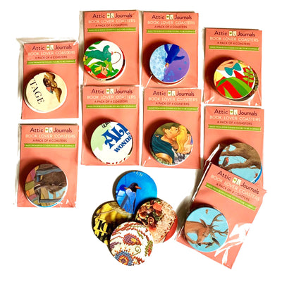Packages of drink coasters made from recycled board books. Variety of colors and patters.